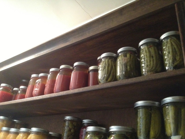 Top shelf: tomato juice, Bloody Mary mix, dilly beans.