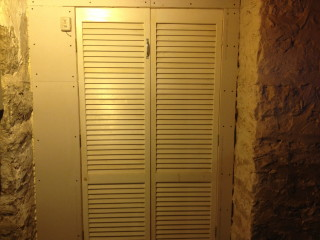 The doors to the root cellar. Thankfully not as dungeon-y as I thought they'd be.