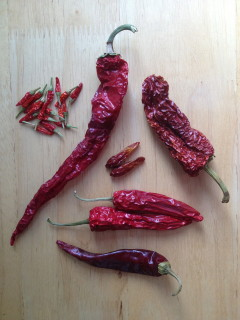 A variety of dried red chili peppers.