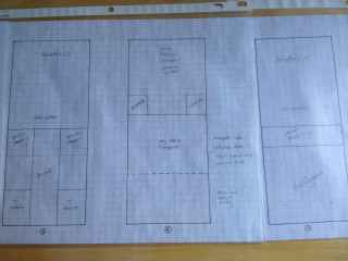 """My garden plans for this year. Each square equals 3"""" on the graph paper. I put them into plastic sleeves so they don't get trashed when I have them outside. Don't laugh at me."""